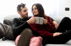 couple drinking tea on sofa